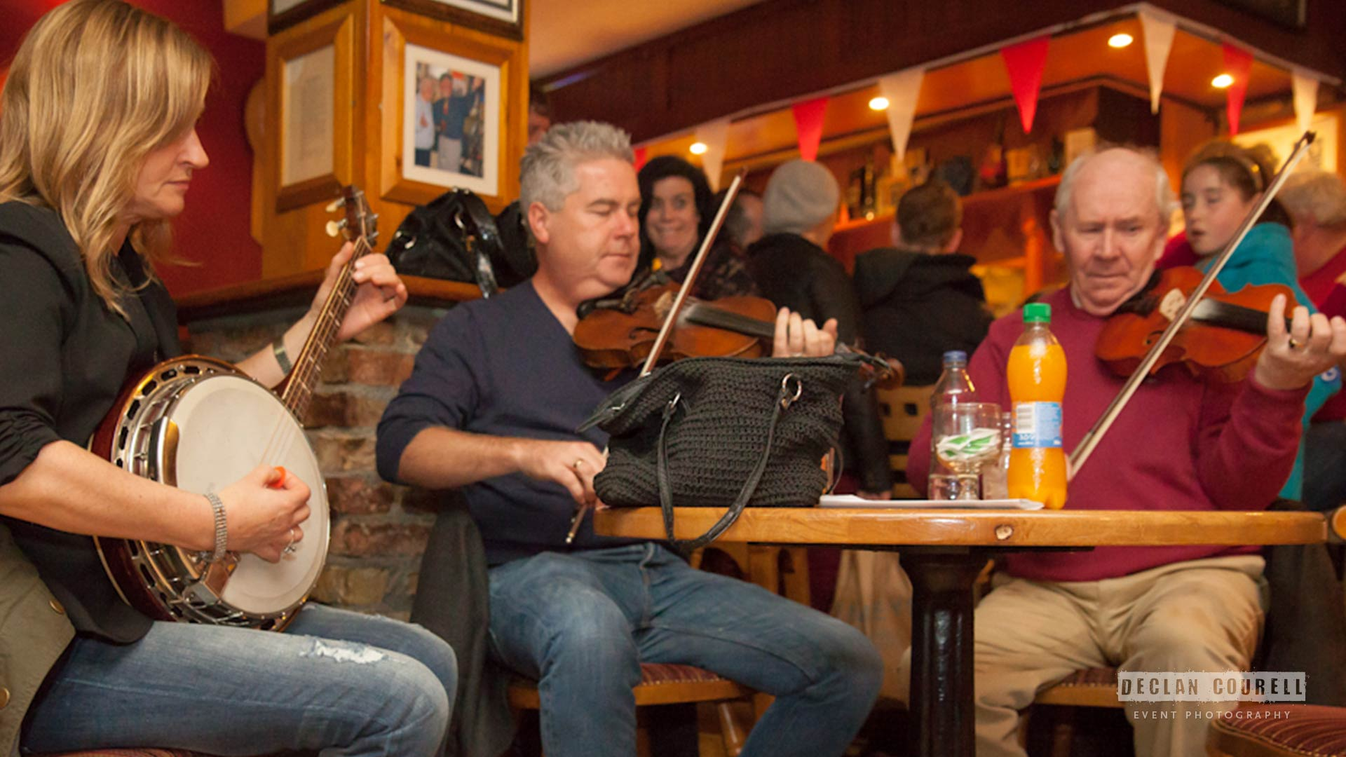 Tommy McCarthy and Louise Costello<br /> having a tune after their concert with<br /> We Banjo 3 in Sligo Live 2014.